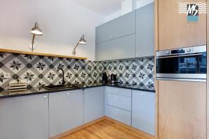 Kuchnia lub aneks kuchenny w obiekcie MS Apartments Top Center II
