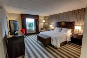 A bed or beds in a room at Hampton Inn Neptune