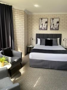 A bed or beds in a room at Beach Park Motel