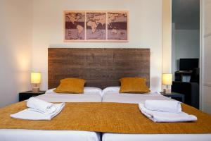 A bed or beds in a room at Résidence mmv Les terrasses d'Isola