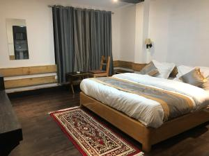 A bed or beds in a room at The Mystique valley