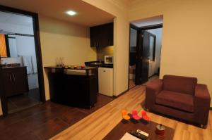 مطبخ أو مطبخ صغير في فندق سويت ميرلوت - بيروت