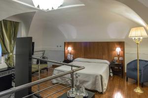 A bed or beds in a room at Albergo del Senato