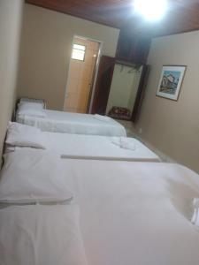 A bed or beds in a room at Pousada Thamalu