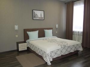Кровать или кровати в номере Гостиница Минутка