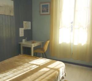 Un ou plusieurs lits dans un hébergement de l'établissement Résidence Fleur des Pins - Gites & Chambres d'Hôtes