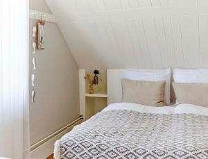 Un ou plusieurs lits dans un hébergement de l'établissement Hotel Zonne