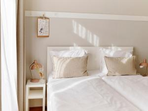 Ein Bett oder Betten in einem Zimmer der Unterkunft Hotel Zonne