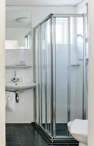 Ein Badezimmer in der Unterkunft Hotel Zonne