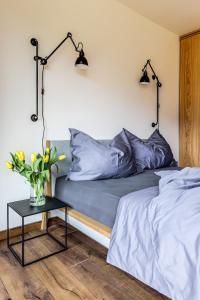 Postel nebo postele na pokoji v ubytování Výhledy Stolová