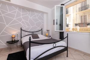 Un ou plusieurs lits dans un hébergement de l'établissement Celenya Hôtel