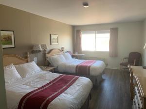 Кровать или кровати в номере Hotel Transit