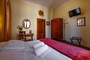A bed or beds in a room at B&B Villa Giulia