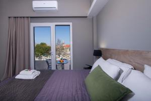A bed or beds in a room at Stoa Suites Chania