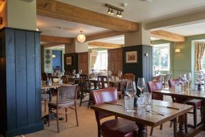 A restaurant or other place to eat at Beckford Inn