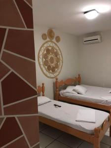 Cama ou camas em um quarto em Pousada Serra Negra