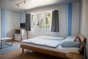 Ein Bett oder Betten in einem Zimmer der Unterkunft Beachhouse Isleten