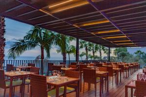 A restaurant or other place to eat at VidaMar Resort Hotel Madeira - Dine Around Half Board