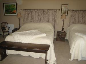 A bed or beds in a room at The Mohair Farm