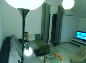 A seating area at Apartment Dino