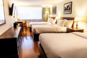 A bed or beds in a room at Radisson Bogota Metrotel