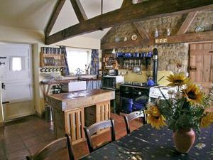 The lounge or bar area at Brook Cottage