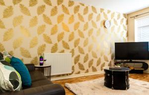A television and/or entertainment center at Graceful Home Away Sittingbourne