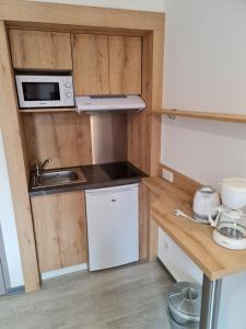 A kitchen or kitchenette at Le Moulin du Verdon