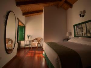 A bed or beds in a room at Casa Blanco