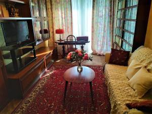 Гостиная зона в Apartment on Prospekt Marshala Blyukhera