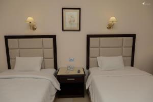 سرير أو أسرّة في غرفة في فندق سي ستار بوريفاج
