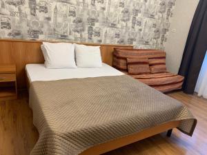 Кровать или кровати в номере Ренессанс Гостевой дом