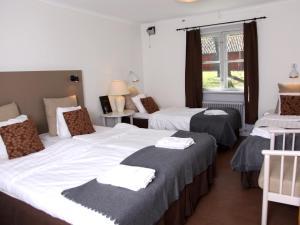 Säng eller sängar i ett rum på Gripsholms BnB