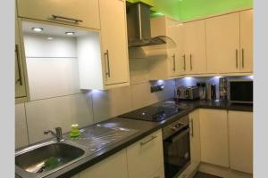 A kitchen or kitchenette at Stones Throw Apartment
