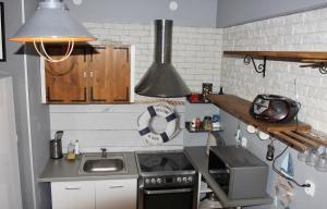 Kuchnia lub aneks kuchenny w obiekcie Apartament DELTA przy plaży, miejsce parkingowe