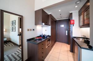 A kitchen or kitchenette at Al Maha Arjaan by Rotana