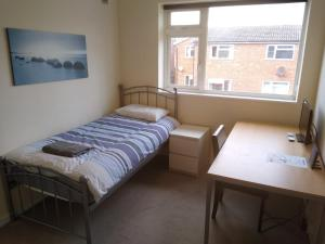 A bed or beds in a room at Contractors Flat