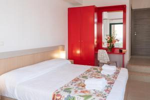 Letto o letti in una camera di Lucia Simona Villas