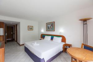 A bed or beds in a room at Samba Angra dos Reis