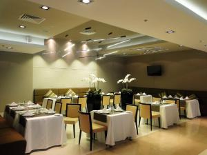 A restaurant or other place to eat at Victoria & SPA Minsk