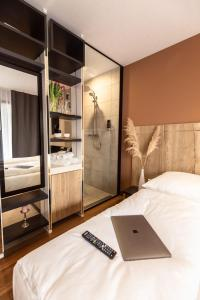 A bed or beds in a room at 24Seven Hotel Schwabach