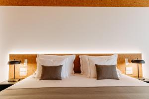 Un ou plusieurs lits dans un hébergement de l'établissement Canadiano Urban Nature Hotel