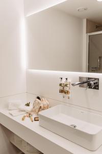 Salle de bains dans l'établissement Canadiano Urban Nature Hotel