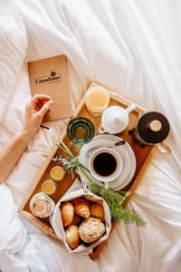 Options de petit-déjeuner proposées aux clients de l'établissement Canadiano Urban Nature Hotel