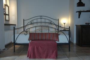 Кровать или кровати в номере Argoulias