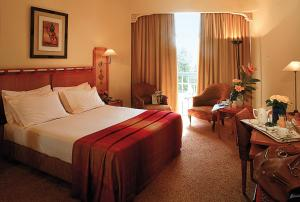 A bed or beds in a room at Es Saadi Marrakech Resort - Hotel