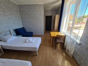 Кровать или кровати в номере Guest house Granat