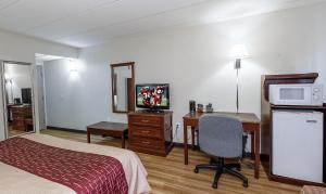 A television and/or entertainment center at Red Roof Inn Hartford - Vernon