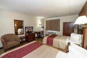 A bed or beds in a room at Red Roof Inn Hartford - Vernon