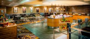 A restaurant or other place to eat at The Park Royal - QHotels